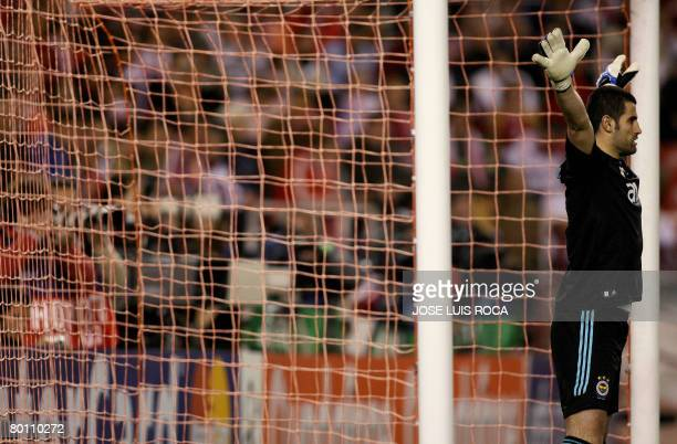 Fenerbahce's goalkeeper Volkam Demirel waits for a penalty by a Sevillan player during a Champions league return leg football match at the Sanchez...