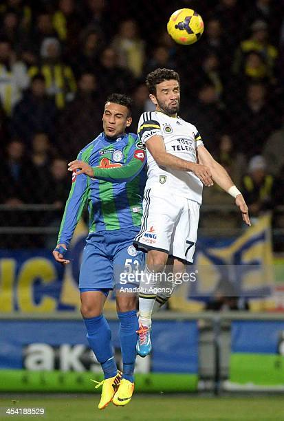 Fenerbahce's Gokhan Gonul and Ali Adnan of Caykur Rizespor rise for the ball during the Turkish Spor Toto Super League match between Caykur Rizespor...