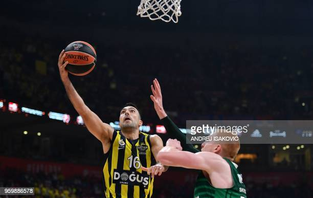 Fenerbahce's Greek guard Kostas Sloukas fights for the ball with Zalgiris' US forward Aaron White during the first semifinal EuroLeague Final Four...