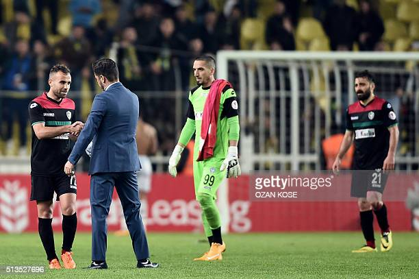 Fenerbahce`s head coach Vitor Pereira congratulates Amedspor's players after the Zirrat Turkish Cup football match between Fenerbahce and Amedspor at...