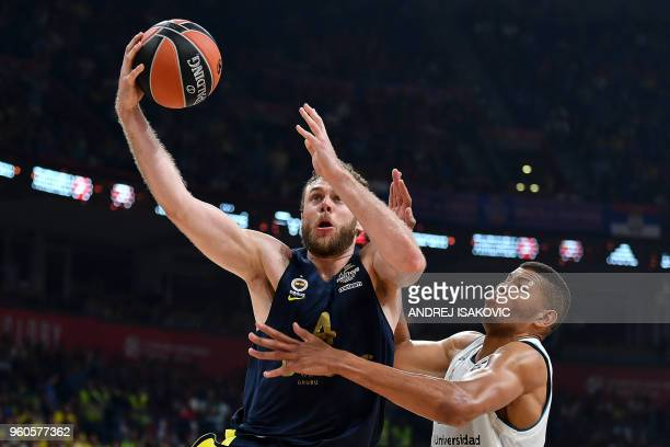 Fenerbahce's Italian forward Nicolo Melli fights for the ball against Real Madrid's Cape Vardean center Walter Tavares during the Euroleague Final...