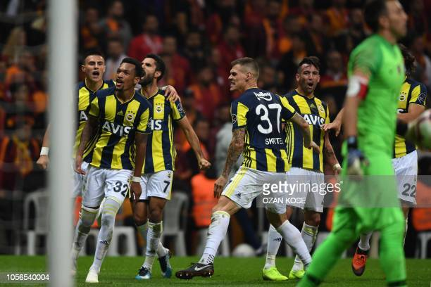 Fenerbahce's Jailson celebrates with teammates after scoring a goal during the Turkish Spor Toto Super league fotball match between Galatasaray and...