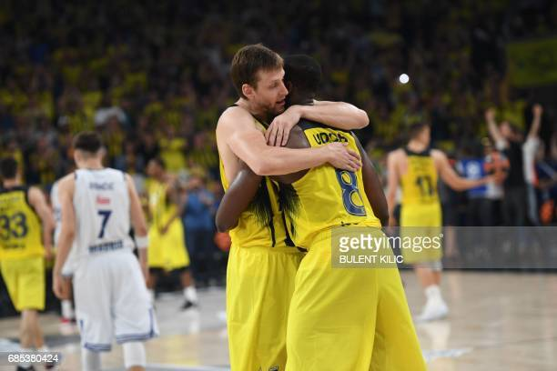 Fenerbahce's Jan Vesely and Ekpe Udoh celebrate after winning the semifinal basketball match between Fenerbahce Ulker vs Real Madrid at the...