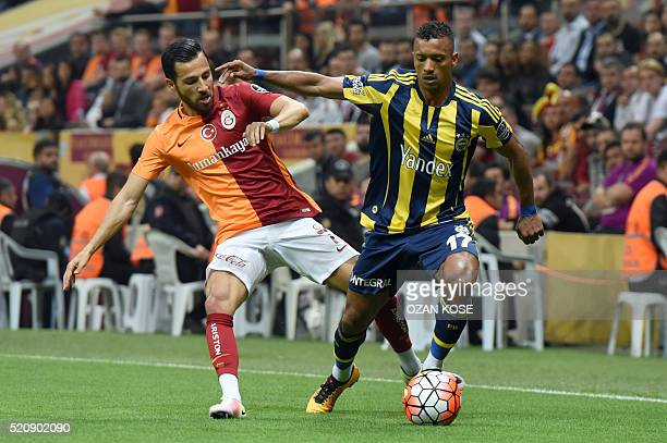 Fenerbahce`s Luis Nani vies for the ball with Galatasaray`s Yasin Oztekin during the Turkish Spor Toto Super league football match between...