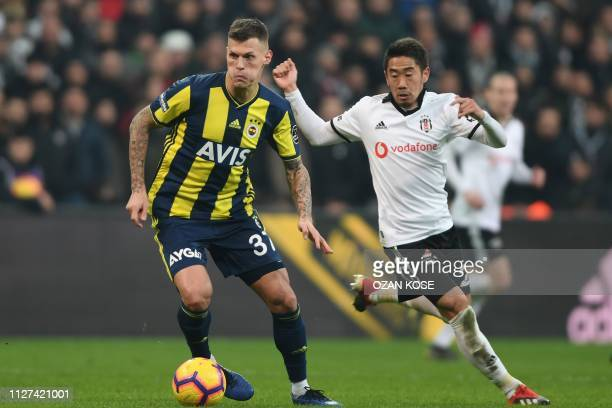 Fenerbahce's Martin Skrtel vies with Besiktas' Shinji Kagawa during the Turkish Super Lig football match between Besiktas and Fenerbahce on February...