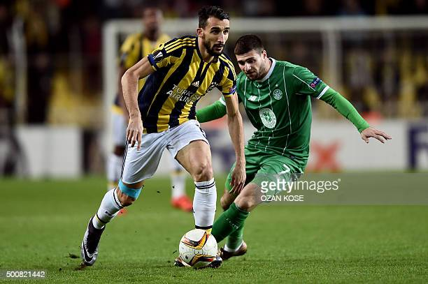 Fenerbahce's Mehmet Topal vies Celtic's Nadir Ciftci during the UEFA Europa League football match between Fenerbahce and Celtic at Fenerbahce Sukru...