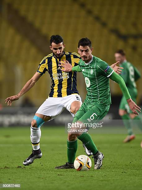 Fenerbahce's Mehmet Topal vies with Celtic's Nadir Ciftci during the UEFA Europa League football match between Fenerbahce and Celtic at Fenerbahce...
