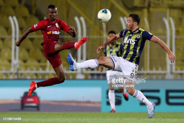 Fenerbahce's Mevlut Erdinc in action against Kayserispor's Bernard Mensah during the Turkish Super League football match between Fenerbahce SK and...