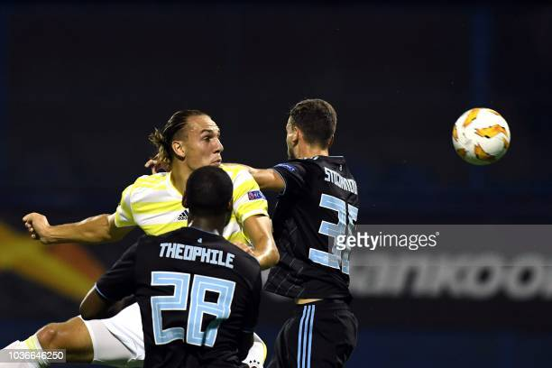 Fenerbahces' Michael Frey vies with Dinamo's Petar Stojanovic and Kevin Theophile-Catherine during the Europa League group D match between Dinamo...
