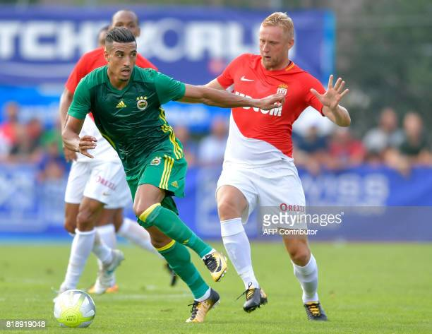 Fenerbahce's MoroccanBelgiqn midfielder Nabil Dirar outruns Monaco's Polish defender Kamil Glik during a friendly football match between AS Monaco...