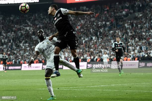 Fenerbahce's Moussa Sow vies for the ball with Besiktas' Brazilian defender Adriano Correia during the Turkish Spor Toto Super Lig football match...