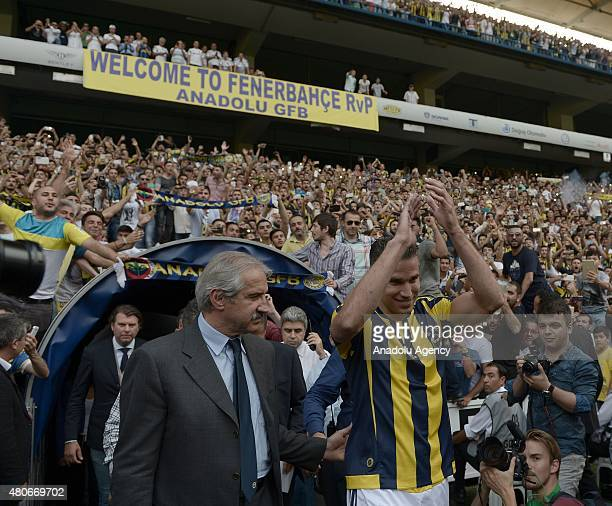 Fenerbahce's new transfer Dutch footballer Robin van Persie arrives at the Fenerbahce Sukru Saracoglu Stadium to sign fouryear contract with...
