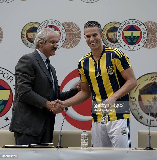 Fenerbahce's new transfer Dutch footballer Robin van Persie shakes hand Fenerbahce sporting director Giuliano Terraneo after signing fouryear...
