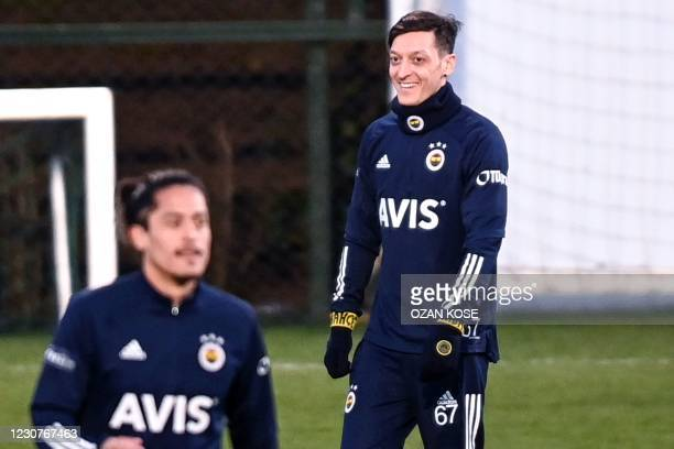 Fenerbahce's new transfer, German midfielder Mesut Ozil , takes part in his first training session with the team on January 24 in Istanbul. - Arsenal...
