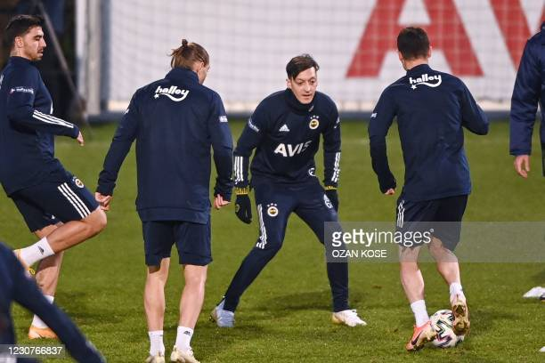 Fenerbahce's new transfer, German midfielder Mesut Ozil , warms up during his first training session with the team on January 24 in Istanbul. -...