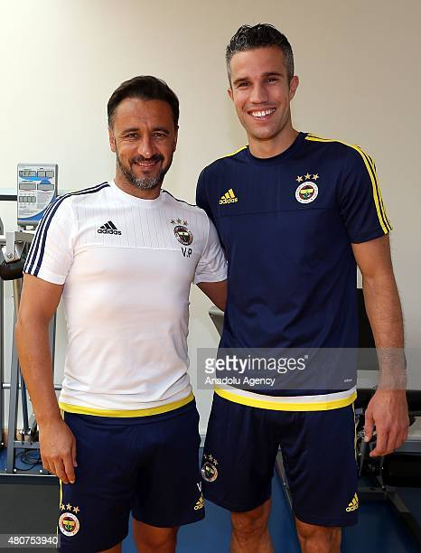 Fenerbahce's new transfer Robin Van Persie meets with his teammate and head coach Vitor Pereira at Can Bartu Complex in Istanbul Turkey on July 15...