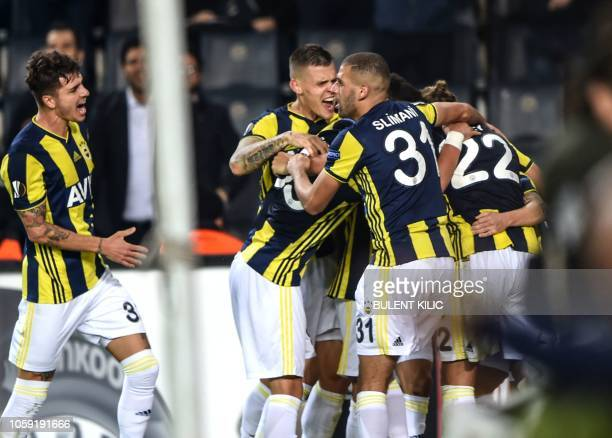 Fenerbahce's players celebrate after scoring a goal during the UEFA Europa League Group D football match between Fenerbahce SK and RSC Anderlecht at...
