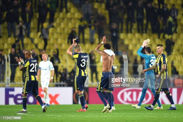 Fenerbahce's players celebrate after winning the UEFA Europa League round of 32 first leg football match between Fenerbahce SK and FC Zenit St...