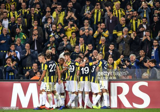 Fenerbahce's players celebrate during the UEFA Europa League Group D football match between Fenerbahce SK and RSC Anderlecht at Ulker Stadium in...