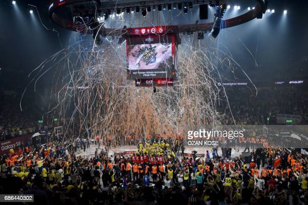 Fenerbahce's players celebrate winning the first place basketball match between Fenerbahce and Olympiacos at the Euroleague Final Four basketball...