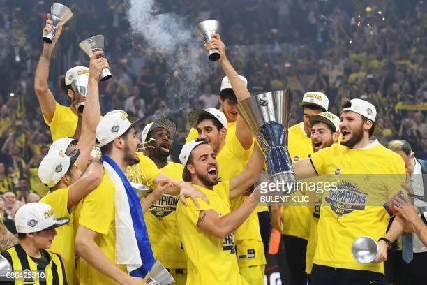 Fenerbahce's players celebrate with the trophy after winning the first place basketball match between Fenerbahce and Olympiacos at the Euroleague...