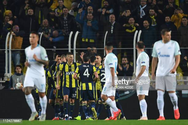 Fenerbahce's players celebrates after Algerian forward Islam Slimani celebrates scored his team's first goal during the UEFA Europa League round of...