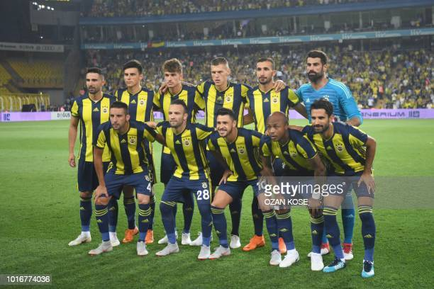 Fenerbahce's players line up for photographers during UEFA Champions league third round second leg qualifying football match between Fenerbahce SK...