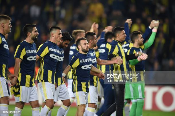 Fenerbahce's players with French midfielder Mathieu Valbuena celebrate after winning the UEFA Europa League Group D football match between Fenerbahce...