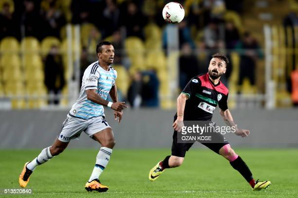 Fenerbahce`s Portuguese forward Luis Nani vies for the ball with Amedspor`s Turkish player Abdullah Cetin during the Zirrat Tukish Cup fotball match...