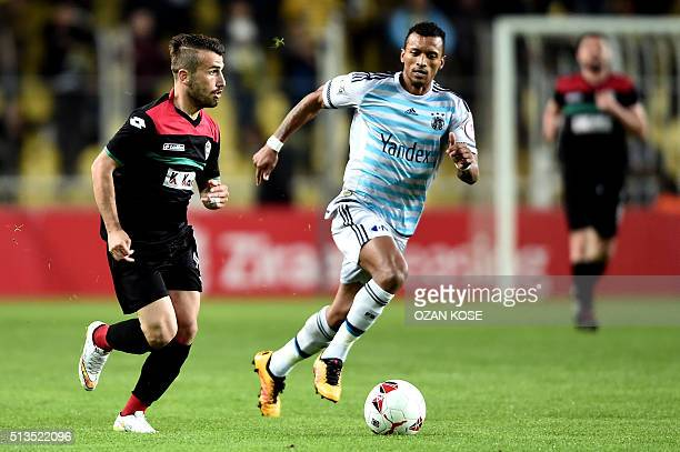Fenerbahce`s Portuguese forward Luis Nani vies for the ball with Amedspor`s Turkish player Abdullah Cetin during the Zirrat Turkish Cup football...