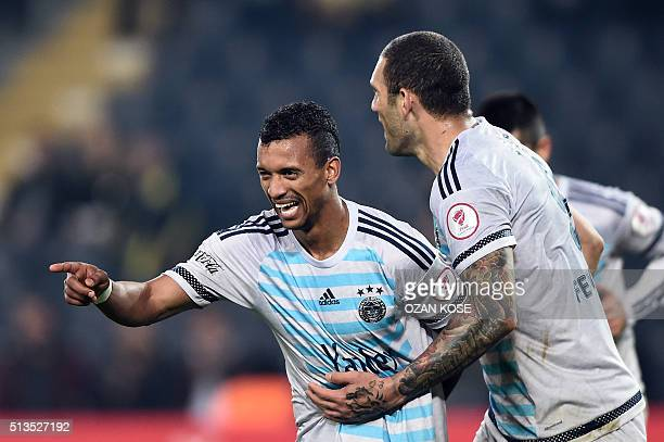 Fenerbahce's Portuguese forward Nani celebrates with his teammates after scoring a goal during the Zirrat Tukish Cup football match between...