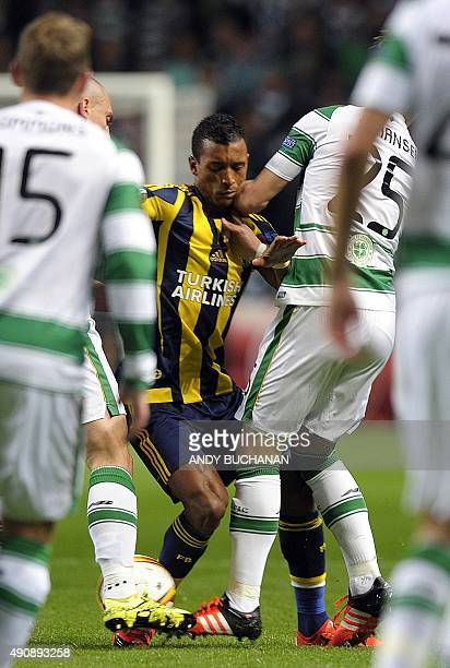 Fenerbahce's Portuguese midfielder Nani is surrounded by Celtic players during the UEFA Europa League group A football match between Celtic and...