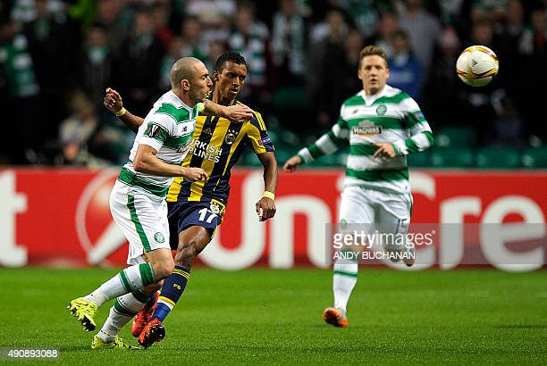Fenerbahce's Portuguese midfielder Nani vies with Celtic's Scottish midfielder Scott Brown during the UEFA Europa League group A football match...