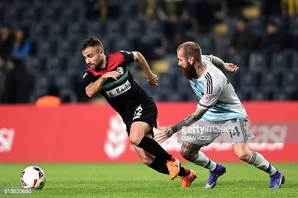 Fenerbahce`s Raul Meireles vies for the ball with Amedspor`s Ercan Capar during the Zirrat Tukish Cup football match between Fenerbahce and Amedspor...