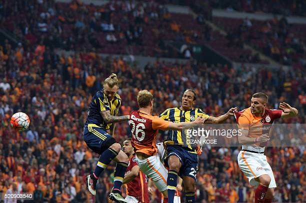 Fenerbahce`s Simon Kjaer with Bruno Alves vies for the ball with Galatasaray`s Semih Kaya and Lukas Podolski during the Turkish Spor Toto Super...