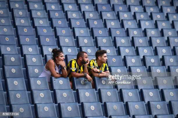 Fenerbahce's supporters arrive in the grandstands before the UEFA Europa League third qualifying round second match Sturm Graz against Fenerbahce on...
