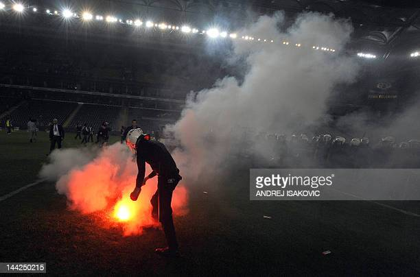 Fenerbahce's supporters clash with police officers after their Turkish Super League playoff final football match between Fenerbahce and Galatasaray...