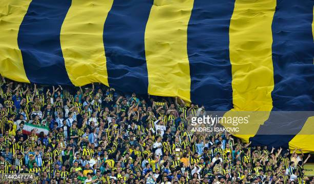 Fenerbahce's supporters unveil a giant flag during the Turkish Super League playoff final football match between Fenerbahce and Galatasaray at Sukru...