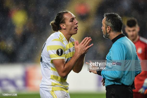 Fenerbahce's Swiss forward Michael Frey speaks to Austrian referee Rene Eisner during the UEFA Europa League Group D soccer match between Fenerbahce...