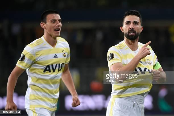Fenerbahce's Turkish defender Hasan Ali Kaldirim celebrates with teammates after scoring a goal during the UEFA Europa League Group D firstleg...