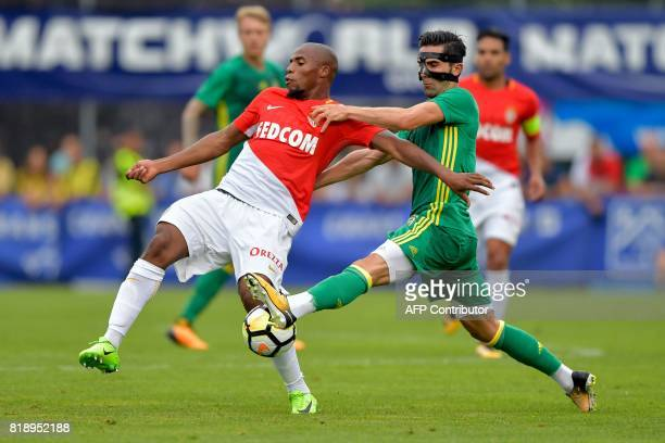 Fenerbahce's Turkish defender Hasan Ali Kaldirim challenges Monaco's French defender Djibril Sidibe during a friendly football match between AS...