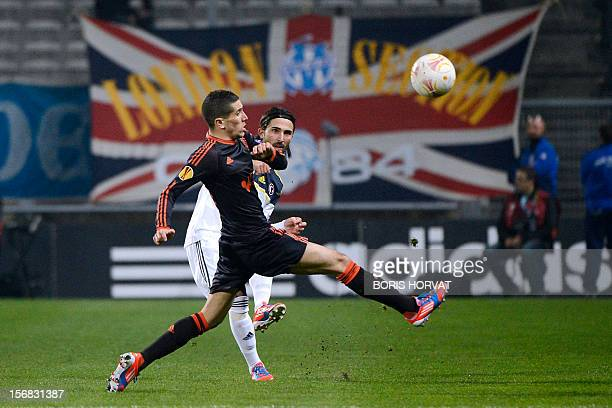 Fenerbahce's Turkish defender Hasan Ali Kaldirim fights for the ball with Marseille's French midfielder Morgan Amalfitano during the UEFA Europa...