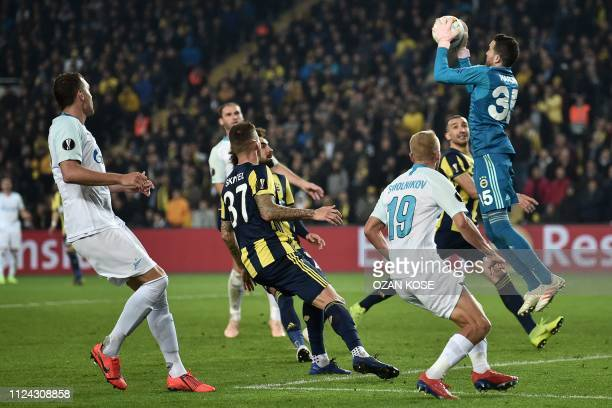 Fenerbahce's Turkish goalkeeper Harun Tekin catches the ball during the UEFA Europa League round of 32 first leg football match between Fenerbahce SK...