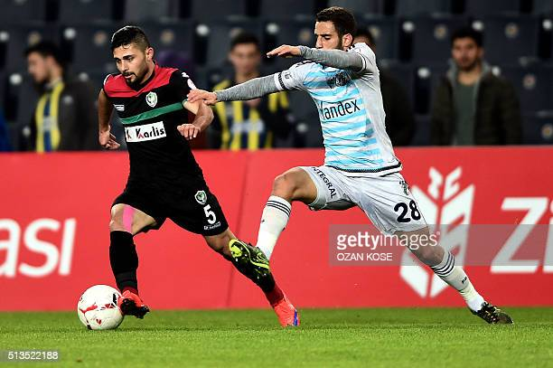 Fenerbahce`s Turkish midfielder Ramazan Civelek vies for the ball with Amedspor`s Turkish defender Ercan Capar during the Zirrat Turkish Cup football...