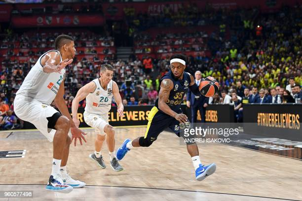Fenerbahce's US guard Ali Muhammed dribbles the ball past Real Madrid's US guard Jaycee Carroll and Real Madrid's Cape Vardean center Walter Tavares...
