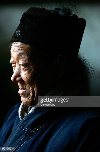 """Feng, a 72-year old Taoist monk, works at a Taoist temple named """"Tian Xin Guan"""" on February 6, 2005 in the countryside of Jinzhai County, Anhui..."""