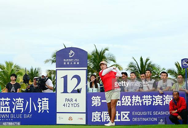 Feng Shanshan of China tees off during the final round of the LPGA Blue Bay Championship at the Jian Lake club in Sanya on the southern Chinese...