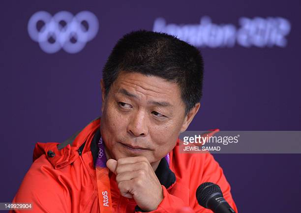 Feng Shuyong leader of China's Track and Field Athletics team addresses a press conference at the Athletics stadium in the 2012 London Olympic Park...
