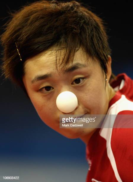 Feng Tian Wei of Singapore serves in her Women's Team Gold Medal Contest against Guo Yan of China at Guangzhou Gymnasium during day four of the 16th...