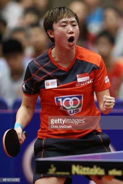 Feng Tianwei of Singapore celebrates a point against Li Fen of Sweden during their Women's Singles Semi final match on day three of 2014 ITTF World...